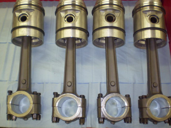 Showing four pistons with connecting rods