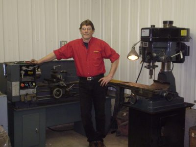 Todd Cory standing next to a machine